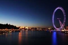 LONDON EYE AT DUSK. A long exposure photo, looking north from Westminister Bridge towards the London Eye stock photo