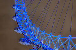 London Eye in England. London Eye panoramic wheel close up at dramatic sky with light pollution in London, UK, middle angle shoot, long expositure stock image