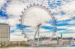 The London Eye ferries wheel, London, UK. LONDON - APRIL 24: The London Eye Panoramic Wheel on April 24, 2013. The ferris wheel is 135 metres (443 ft&#x29 Royalty Free Stock Photos