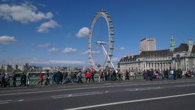 London eye next to the bridge royalty free stock images