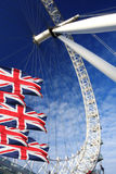 London Eye with flags,  London, UK Stock Photo