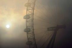 London Eye in the fog. London, United Kingdom - December 11, 2013: The London Eye ferris wheel capsules on a foggy winter morning Stock Photo