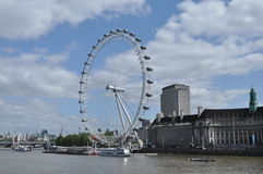The London Eye. This giant Ferris wheel can be found on the South Bank of the River Thames in London. With a height of 135 m,  it used to be the world's tallest Stock Photos