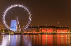 London Eye. The London Eye is a giant Ferris wheel on the South Bank of the River Thames in London.Also known as the Millennium Wheel, its official name was Stock Images