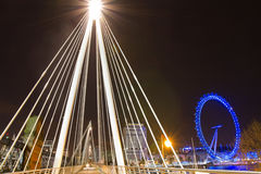 London Eye and Golden Jubilee Bridge Royalty Free Stock Images