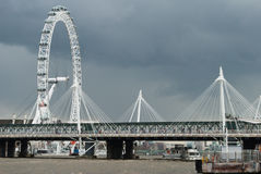 London Eye and Golden Jubilee Bridge. Against a dark April sky Royalty Free Stock Images
