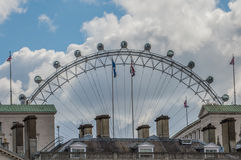 London Eye 2. London Eye hiden by roofs Stock Photo