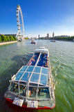 London Eye, Houses of Parliament and River Thames Stock Photography