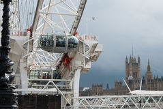 London Eye and Houses of Parliament. Section of the London Eye with grey clouds over the Houses of Parliament in the background Royalty Free Stock Image