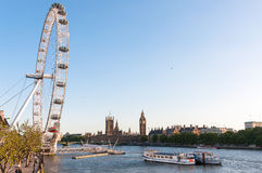 London Eye and Houses of Parliament Royalty Free Stock Photos