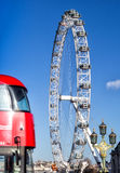 The London Eye and iconic red bus Stock Images
