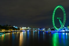 The London Eye illuminated at night Royalty Free Stock Images