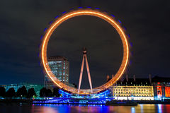 The London Eye illuminated at night Stock Image