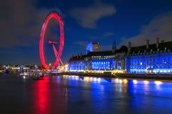 London Eye Illuminated at Night in London, England Stock Photo