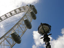 London Eye and Lamp. Walk under the London Eye Royalty Free Stock Photo