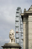 London Eye and Lion Royalty Free Stock Photography