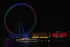 London Eye, lit in party colours on election night Royalty Free Stock Photo