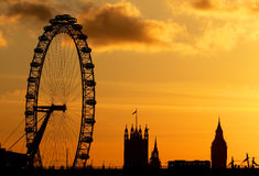 London Eye in London. A sunset view of the London Eye wheel with the Houses of Parliement Tower and Big Ben in the horizon Stock Images