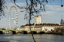 London eye and London Bridge on the River Thames in Autumn, England royalty free stock images