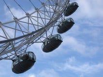 London Eye Ferris Wheel, London, England, United Kingdom. Four of the giant Ferris wheel's 32 ovoidal passenger capsules against a backdrop of blue sky and Stock Photo