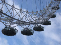 London Eye, London, England, United Kingdom. Six of the giant Ferris wheel's 32 ovoidal passenger capsules against a backdrop of blue sky and white clouds Royalty Free Stock Photos