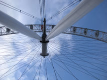 London Eye Ferris Wheel, London, England, United Kingdom. View from the ground, looking straight up at the giant Ferris wheel and the blue sky and white clouds Royalty Free Stock Photos