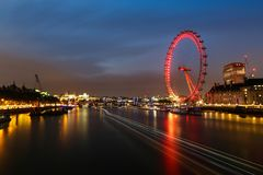 London Eye Long Exposure. Long exposure of traffic on the River Thames, with the London Eye in the background royalty free stock images