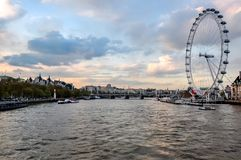 London Eye Millenium wheel and Thames river at sunset, London, UK royalty free stock photography