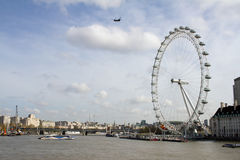 London eye millennium wheel and ferries Royalty Free Stock Photography