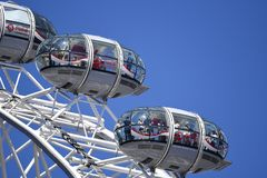 London Eye Millennium Wheel. Members of the public in the pods royalty free stock photography