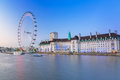 The London Eye near the River Thames  in London. LONDON, ENGLAND - May 14, 2016 : The London Eye near the River Thames  in London at dusk, England. The London Stock Images