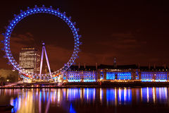 London Eye at night. The London eye at night is spectacular sight. Originally intended to be a temporary structure for the Millennium it now is a must for Stock Photos