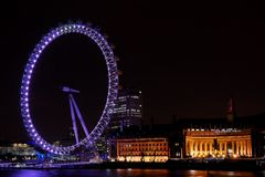 London Eye at night. London Eye carusel next to Thames river in London, United Kingdom Royalty Free Stock Image
