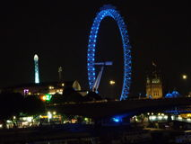 London eye at night. The London eye from bridge in London at night Royalty Free Stock Images