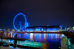 London Eye at night. LONDON - MAR 30: London Eye at night with river Thames on Mar 30, 2014 in London, UK. At a height of 135 meters, London Eye is the tallest Stock Images