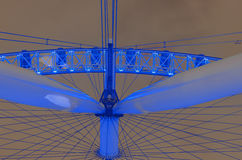 London Eye at night. London Eye panoramic wheel close up at dramatic sky with light pollution in London, UK, middle angle shoot, long expositure royalty free stock images