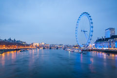 London Eye at night with river Thames in London, UK Stock Photos