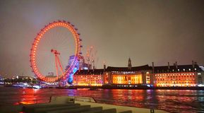 London Eye at night by the River Thames. Night view when cruising the River Thames in Central London with the iconic London Eye ferris wheel at the South bank of Stock Photography
