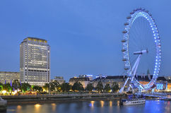 London Eye in the night with surroundings Stock Photography