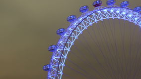 London eye at night tilt down zoom out stock video footage