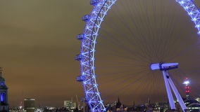 London eye at night tilt up right timelapse stock video footage