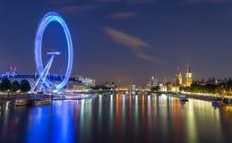 London Eye at night. View on London Eye and Big Ben from Embankment bridge Stock Image
