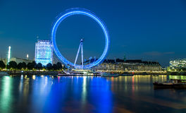 London Eye at night. View on London Eye from Embankment pier and  river Thames Stock Images