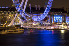 London Eye night view. On the London Thames River Royalty Free Stock Photos