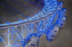 London Eye. Panoramic wheel close up at dramatic sky with light pollution in London, UK, middle angle shoot, long expositure royalty free stock images