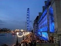 London Eye. People enjoying the night Royalty Free Stock Photo
