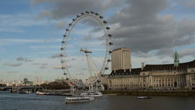 London Eye. People walk on the street with London Eye in background stock video