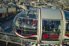 The london eye pod having the people who are having drinks and other things on board. London, England - November 18, 2018: The london eye pod having the people royalty free stock photos
