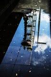 London Eye Rain London Mirror Image. Rainy Thames River Stock Photo