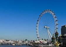 The London Eye and River Thames. With blue sky on the background in London , UK Royalty Free Stock Photos